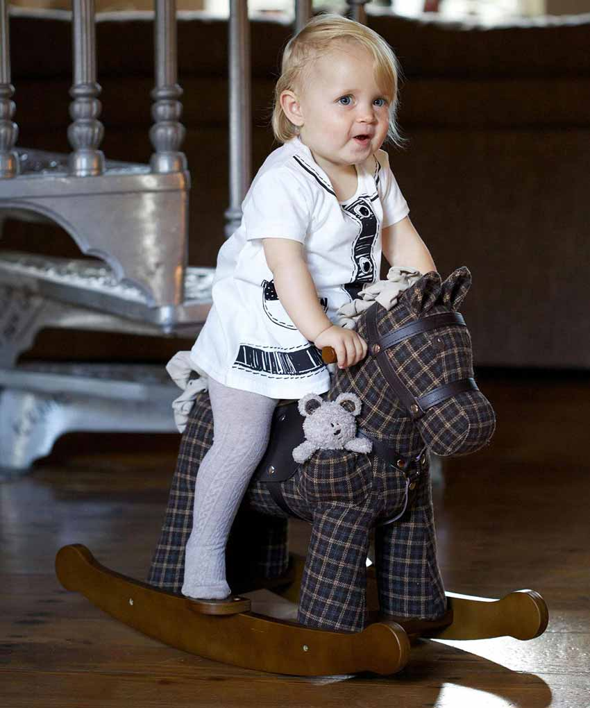 Little Girl playing on Rufus & Ted Rocking Horse